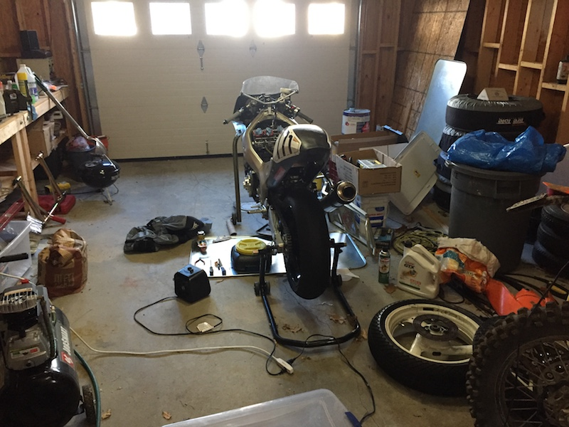 A-ko partially torn down in a messy garage.
